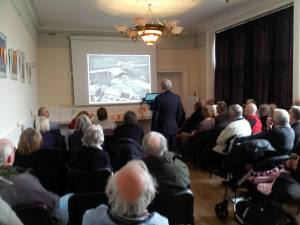Ken Cothliff speaking to a packed audience about the history of Leeds Bradford