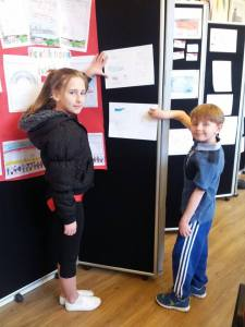 Children show of their Art of what they do and do not like in Aireborough.